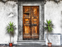 Entrance door. Courtyard with wooden entrance door Royalty Free Stock Images