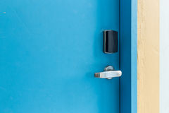Entrance door with electronic keycard lock system Stock Photo