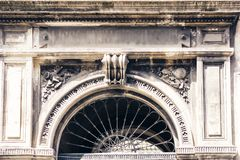 Entrance door, facade of old baroque building in Catania, traditional architecture of Sicily, Italy.  stock photography