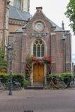 Entrance door of the Grote Kerk (Sint-Bavokerk) in Haarlem Royalty Free Stock Photography