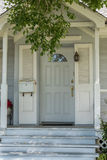 Entrance door. House entrance door with half moon lite and side panels Royalty Free Stock Photos