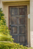 Entrance door. Entrance house old wooden door with peeled paint and scratches Royalty Free Stock Photos