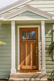 Entrance door. House entrance door with one third lite and cape hood Stock Photography
