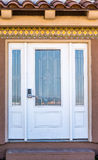 Entrance door. House entrance door with two thirds lite with arctic glass inserts and two side panels Stock Photography
