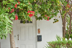 Entrance door with number two. And shrubs Royalty Free Stock Images