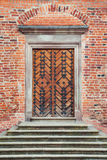 Entrance door in old castle Stock Photos