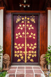 Entrance door with painting and double singha. Red door with painting tree and two singha Royalty Free Stock Photos