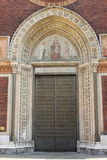Entrance door of a romanic style church Royalty Free Stock Image