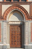 Entrance door of a romanic style church Stock Photos
