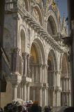 Entrance Door of St. Mark`s Basilica. Entrance Gate of St. Mark`s Basilica in Venice crowded with visiting tourists Royalty Free Stock Images