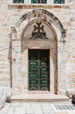 The entrance door to the Armenian part of the Church of the Holy Sepulchre in Jerusalem, Israel. Jerusalem, Israel, July 14, 2017 : The entrance door to the Royalty Free Stock Photography