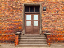 Entrance door to the brick building Stock Photos
