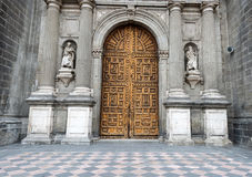 Entrance door to Metropolitan Cathedral in Mexi. Wooden entrance doors to The Metropolitan Cathedral of the Assumption of Mary of Mexico City. It  is the oldest Stock Photography