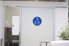 Entrance door to the Public toilet for disabled people. Pregnant women, old people, Toilet sign on door stock images