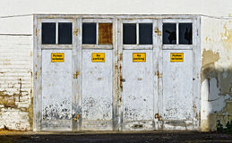 Entrance doors labelled No parking, Royalty Free Stock Image