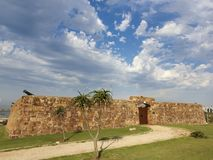 Entrance Doors and Stone Walls of an Old Fort Stock Photo
