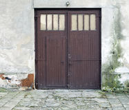Entrance doors to old wears out house Royalty Free Stock Image