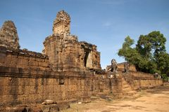 Entrance at East Mebon a hindu temple with stone animal statues on staircase. Scene around the Angkor Archaeological Park. The site contains the remains of the Royalty Free Stock Images