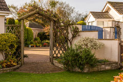 Entrance in english style. A nice gate at the entrance to courtyard Stock Image