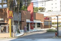 Entrance and façade of a Mc Donads fast-food. Sao Paulo, SP, Brazil, September 21, 2017. Entrance and façade of a Mc Donads fast-food diner in Adolfo royalty free stock image