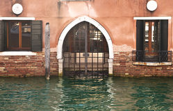 Entrance flooded by high water in Venice Stock Images