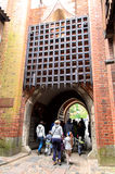 Entrance gate of the biggest castle in Europe. Photo shows group of people coming into Malbork castle in Poland. The castle built in gothic style used to be Royalty Free Stock Image