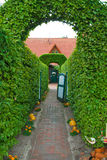 Entrance gate in a country house. Under the topiary arches Royalty Free Stock Images