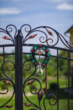 Entrance gate. At the front gate hanging wreath with crucified Stock Photos