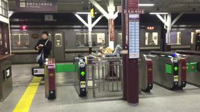 Entrance gate at the JR train station in Tokyo, Japan. People pass the entrance gate at the JR train station in Tokyo, Japan stock video footage