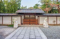 The entrance gate with lion sculptures of the Kotoku-in Temple Stock Photography