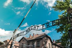 Entrance gate of the nazi concentration camp of Auschwitz in Poland: work will make you free royalty free stock photos