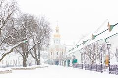 Entrance gate of the Pechersk Lavra in Kiev, Ukraine. The Gate Church of the Trinity in winter snow stock photos