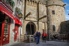 Entrance gate and restaurant at the entrance to the medieval city of Saint Michel Abbey royalty free stock images