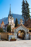 Entrance gate and Saint Nicholas Church in Brasov Royalty Free Stock Photography
