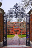 Entrance gate and Sever Hall in Harvard Yard of Cambridge. Entrance gate and East facade of Sever Hall in Harvard Yard in Harvard University of Cambridge Royalty Free Stock Photo