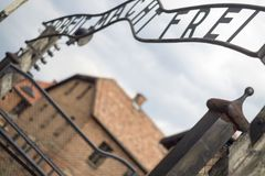 Auschwitz main entrance. Entrance gate to Auschwitz concentration camp in Poland, the famous written ARBEIT MACHT FREI from German: Work makes free Royalty Free Stock Photography