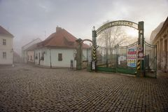 The entrance gate to the old brewery and malting plant on a foggy winter day. Znojmo, Czech Republic royalty free stock image