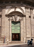 Entrance gate to the Temple of San Sebastiano late Renaissance Mannerist style church in central Milan. The octagonal church was put into operation in 1576 Stock Photo