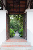 Entrance gate to tropical garden Stock Photo