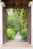 Entrance gate to tropical garden Royalty Free Stock Photo