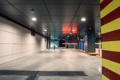 Entrance gate to underground garage parking lot, auto park interior inside. Toned stock image