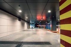 Entrance gate to underground garage parking lot, auto park interior inside. Toned Stock Image