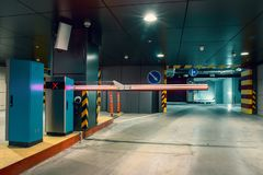 Entrance gate to underground garage parking lot, auto park interior inside. Toned stock photos