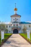 Entrance gate to white monastery Stock Image