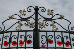 The entrance gates to The Rhyl Garden of Rememberance. Rhyl, UK: June 3, 2018: Artificial poppies attached to The Garden of Remembrance entrance gates, Rhyl. It Stock Images