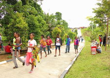The Entrance of the Gospel in Papua Island. Crowdy people walking to and from the Jesus Redeemer Statue in Manokwari, West Papua. It was an annual big religious Royalty Free Stock Image