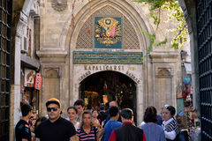 Entrance of Grand Bazaar, Istanbul, turkey. On the foreground a crowd of tourist Royalty Free Stock Photography