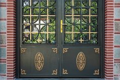 Entrance of Greek Orthodox Church. Details of Greek Orthodox church, part of an entrance, decorated metal doors Royalty Free Stock Image