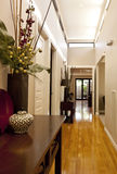 Entrance Hall. Of new showcase home, with polished floorboards, downlighting, and elegant decor royalty free stock image