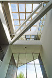 Entrance hall of business office. Office building interior lobby with skylight and glass entranceway Stock Photography